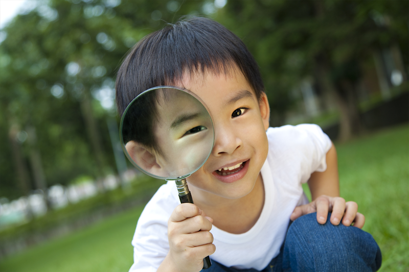 Boy with magnifying glass